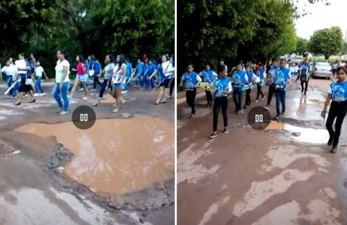 Crianças de Presidente Figueiredo desfilam entre buracos, lama e lixo
